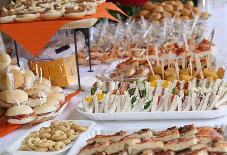 many sandwiches and sandwiches with mayonnaise on the table during party