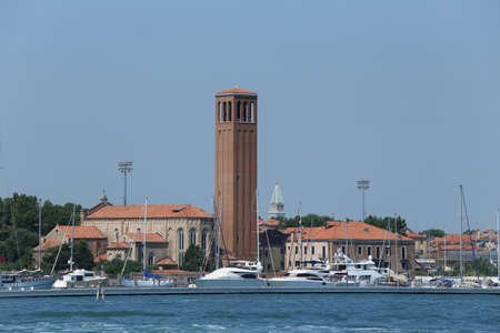 bell tower of Saint Elena in Venice in Italy and th boat Editorial