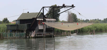 Special stilts houses with fishing nets for fishing on the river