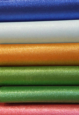 backgrounds of colored glitter sheets to prepare customized decorations for Christmas Stock Photo