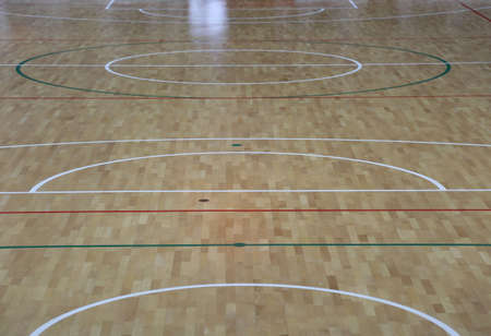 wooden parquet with the lines of the basketball court and volleyball court