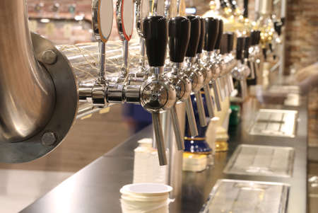 many taps of the brewery to spice fresh beer to quench the customers of the pub