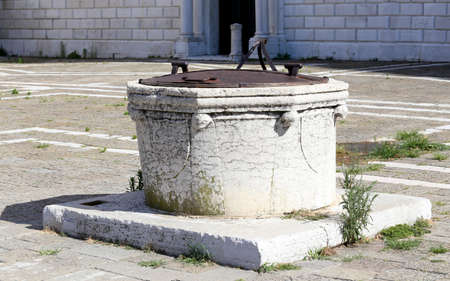 ancient well to gather rainwater on the island of Venice Italy Stock Photo