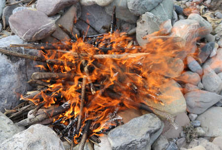 big bonfire made with stones in a circle with a lively flame of fire Stock fotó