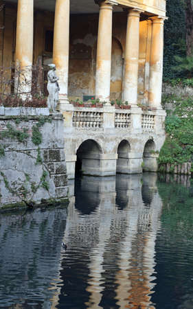 very ancient villa in the city of Vicenza called Loggia Valmarana with the pond Editorial