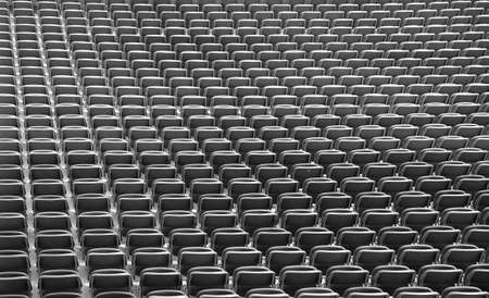 so many gray chairs without the spectators in the big sports facility before the sporting event Stock Photo