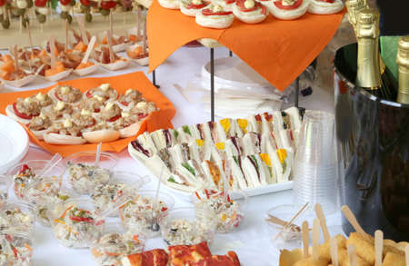 many sandwiches and sandwiches with mayonnaise in the party reception