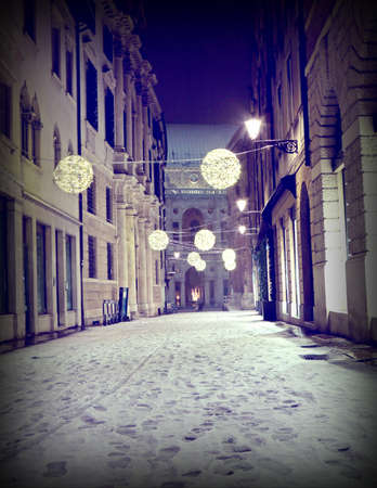 Palace and street in downtown called CONTRA DEL MONTE of Vicenza City in Italy with snow with vintage effect Editorial