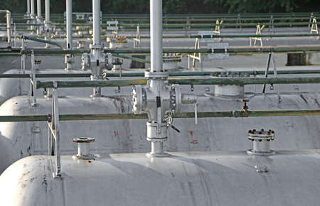 safety and vent valves over the enormous pressure containers for the storage of methane gas in the industrial refinery Stock Photo