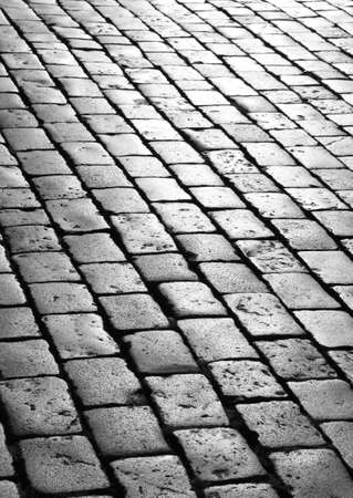 background of gray stones called sampietrini in italian language  for the pavement of the main square europa Banco de Imagens