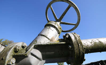 detail of the shut-off valve for closing the industrial plant photographed from below Stock Photo