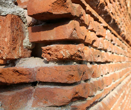 long wall made with many red bricks