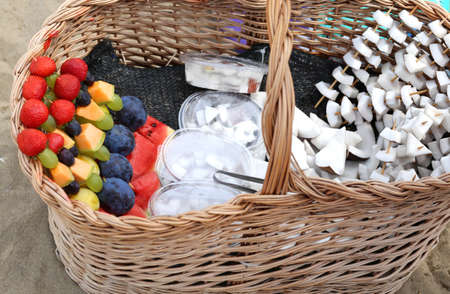 fresh fruit skewers with strawberry plum watermelon and coconut for sale on the beach in summer Stock Photo