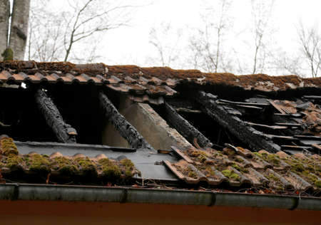 burnt roof of a old house after fire