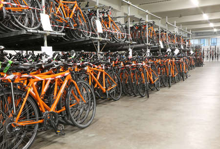 Vicenza, Italy - January 1, 2017:  inside the headquarters of main italian tour operator called Girolibero with many orange bicycles ready to travel