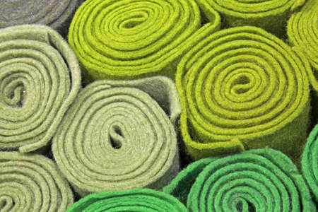 background of many green felt roll on sale in the haberdashery Фото со стока