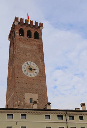 Clock Tower in Bassano del Grappa a small town near Vicenza City in Northen Italy called TORRE CIVICA Stock Photo