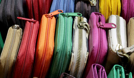 background of many leather wallets with zip for sale in the craft shop