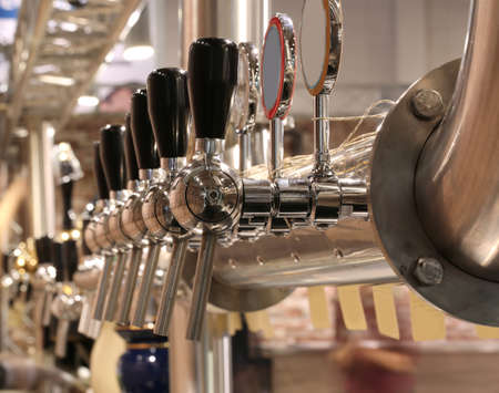 brewery taps to deliver the beer to quench the thirst of the pub customers Stock fotó - 92571469