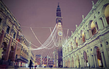Main square called PIAZZA DEI SIGNORI in Vicenza in Italy with snow by night and vintage effect 版權商用圖片