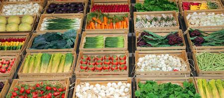 fruit boxes in the shop of greengrocer at market Foto de archivo