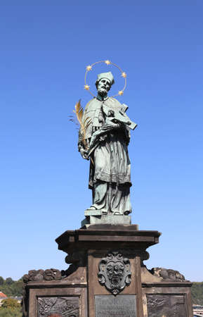 Prague, Czech Republic - August 25, 2016: Ancient Statue of Saint John of Nepomukon the Charles Bridge Editorial