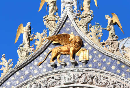 Venice, Italy - July 14, 2016: Big golden LION with wings in the Basilica of Saint Mark. This is the symbol of Venice