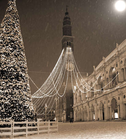 Vicenza City in Italy the Main Square with snow and big Christmas Tree in winter with photo effect