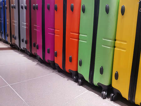colored suitcases of the travelers of the world