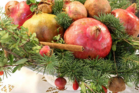 great Christmas centerpiece with pomegranate cinnamon pine needles and other fruit