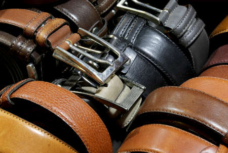 many leather belts in the Italian artisan workshop for sale 免版税图像 - 92988719