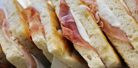 stuffed focaccia sandwiches with smoked bacon for sale Stock Photo