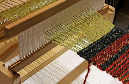 processing of the fabric in the ancient weaving loom made of wood
