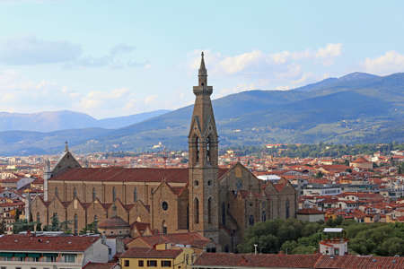 Panoramic view of Church of Holy Cross in Florence called Chiesa di Santa Croce in Italian language and more roofs