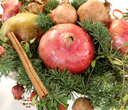 Christmas centerpiece with pomegranate cinnamon pine needles and other fruit