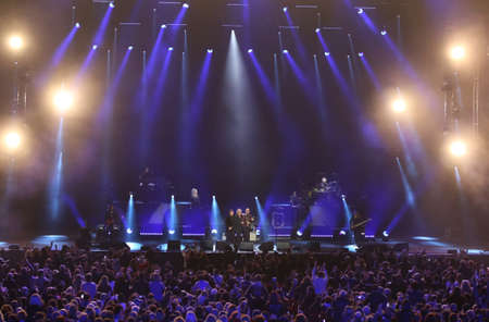Verona, Italy - October 14, 2017: Live Concert of Umberto Tozzi a famous Italian singer with other italian celebrities Morandi Gianni and Ruggeri Enrico and Morandi Gianni at Arena of Verona Editorial