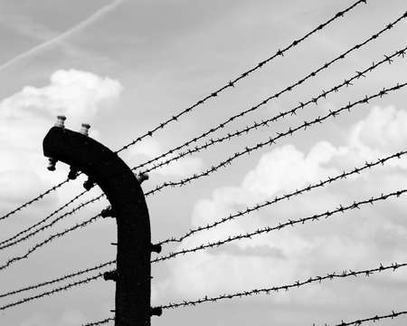 barbed wire with black and white photograph effect in the prison camp