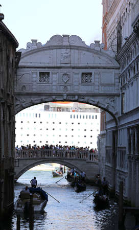 Venezia, Italy - July 14, 2015: Bridge of Sighs and the huge cruise ship in the background  with many people