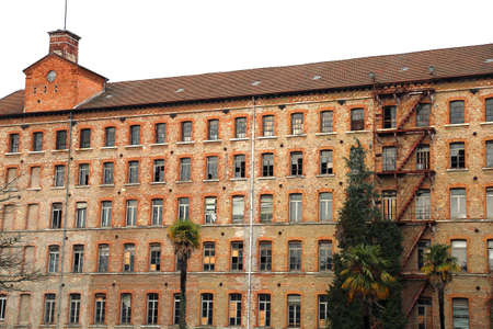 Schio, VI, Italy - March 6, 2016: facade of old factory of the firm called Lanerossi Editorial