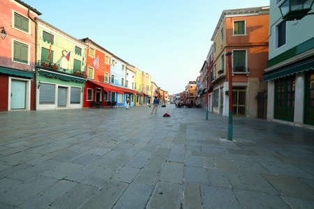 main street of Burano Island near Venice in ITALY in the early morning