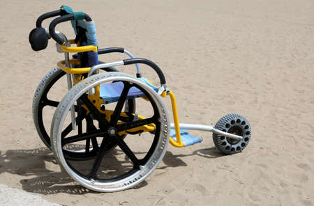 special wheelchair to be able to move on the sand Stock Photo