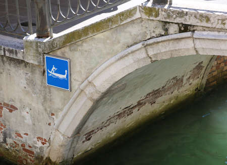very characteristic road sign of the island of Venice in Italy on a bridge Banco de Imagens