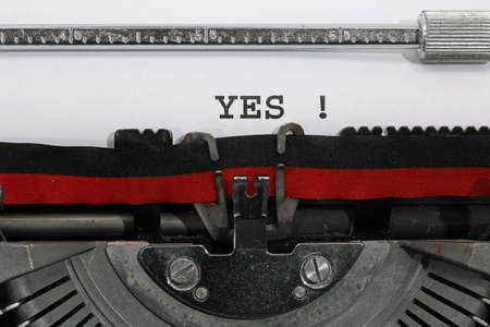 YES written with the old typewriter on white sheet