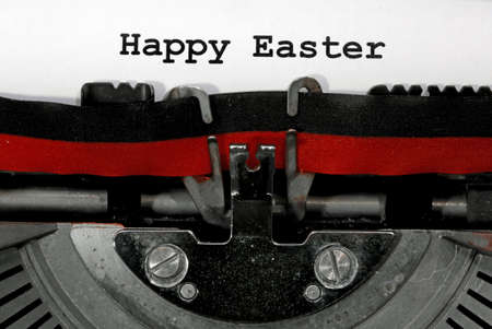 Text Happy Easter written with the old typewriter on white sheet