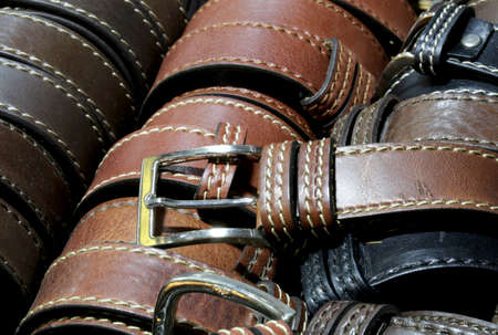 many leather belts for sale in the Italian artisan workshop Stock Photo