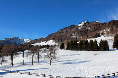 white snow in winter and the high Mountain called SPITZin Northern Italy Stock Photo