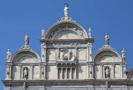 facade with lion winged of an ancient building in Venice called SCHOOL MARCIANA in Italian language. Now it is used as a hospital