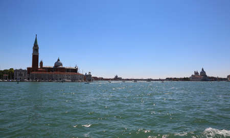 Venice Italy the adriatic sea and the bell tower of church of Saint George called San Giorgio Maggiore in Italian language