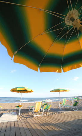 big sun umbrella photographed from below during the summer vacations