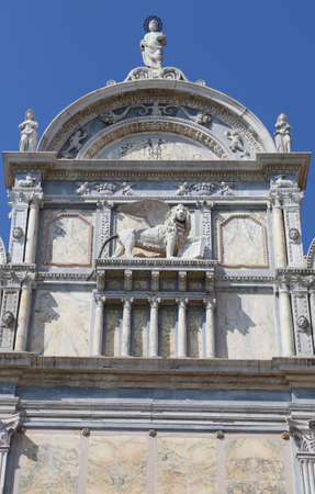 great winged lion of the ancient building in Venice called Scuola Grande di San Marco in the Italian language Stock Photo - 94996642